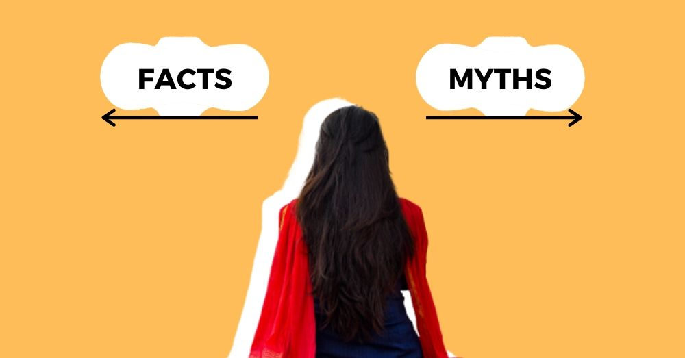 Woman looking at two signs that says facts and myths pointing in opposite directions