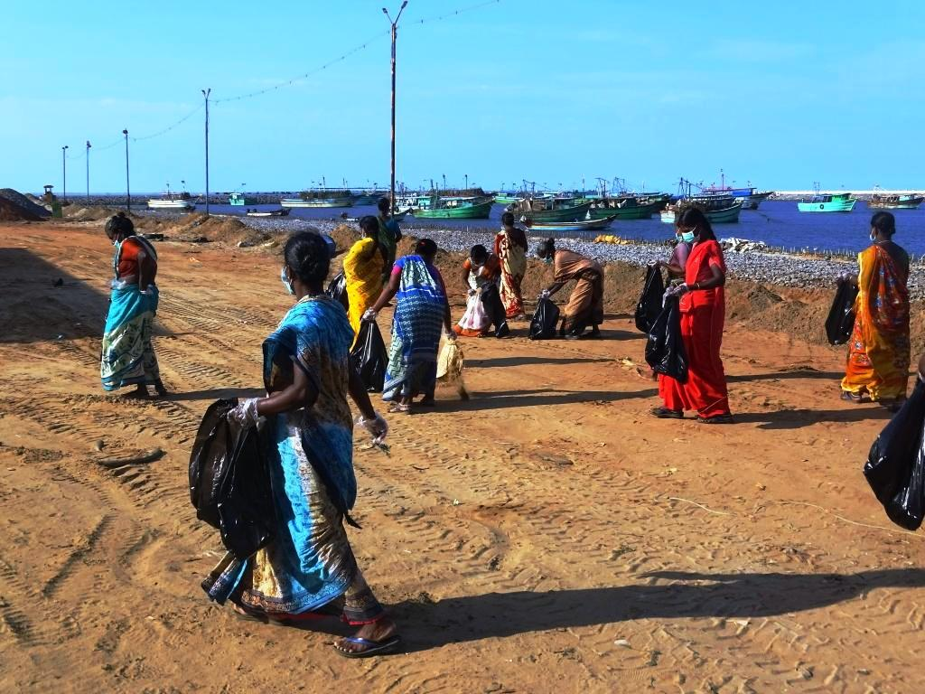 Clean-up drive by fisherwomen on International Mother Earth Day.