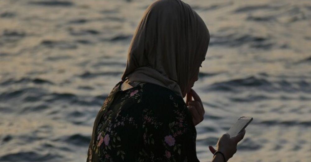 muslim woman silhouette on phone