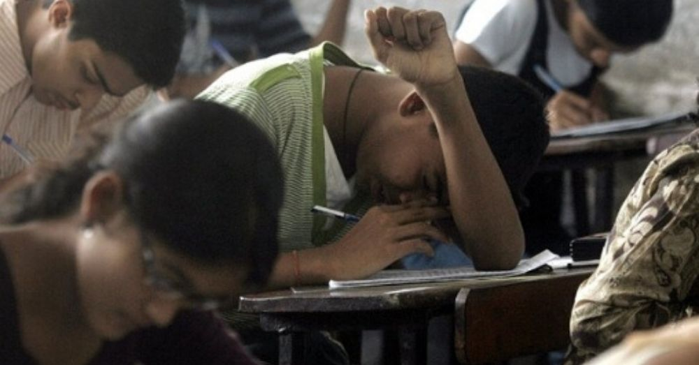 student giving an exam