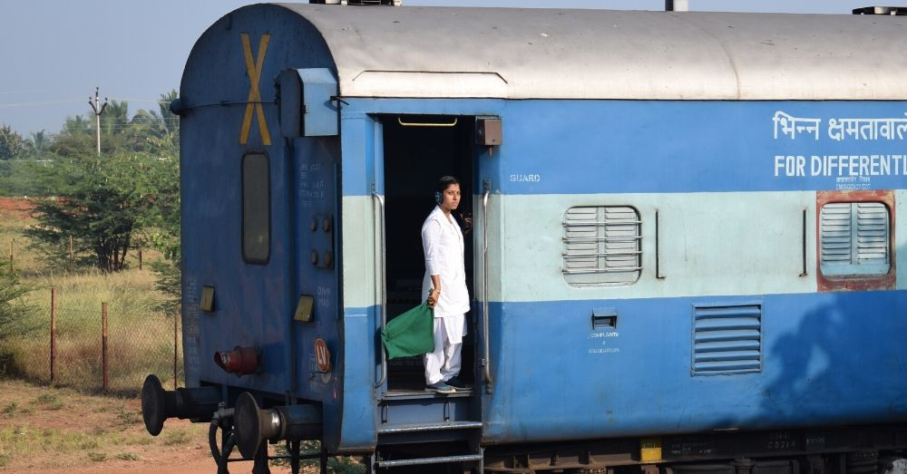 woman guard standing on a train