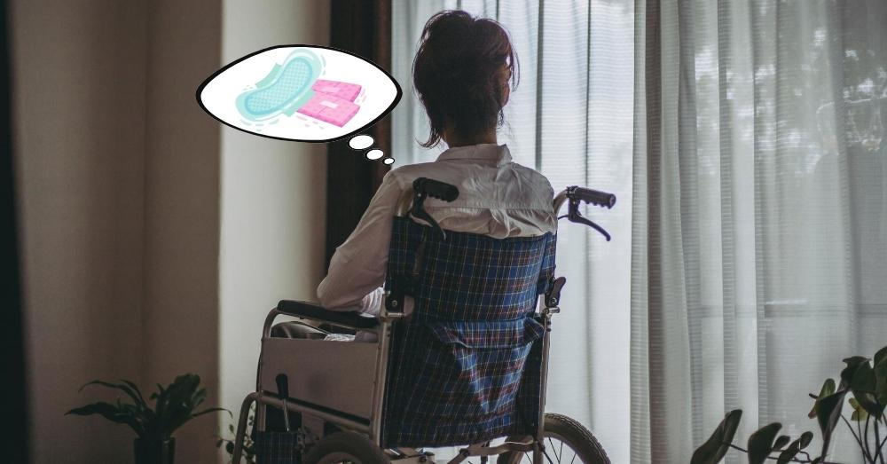 A woman on a wheelchair thinking about sanitary napkins