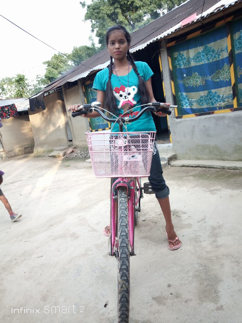 A young girl on a cycle