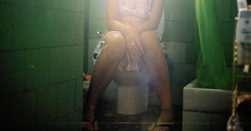 woman sitting in toilet