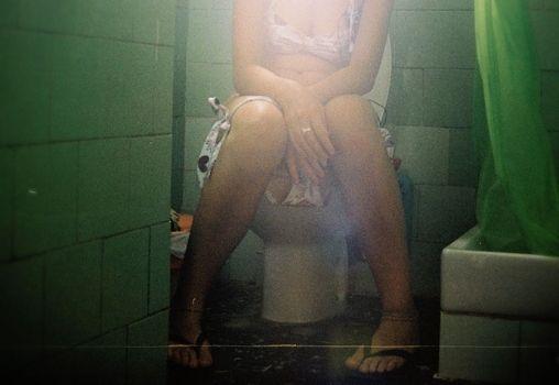 woman sitting in toilet