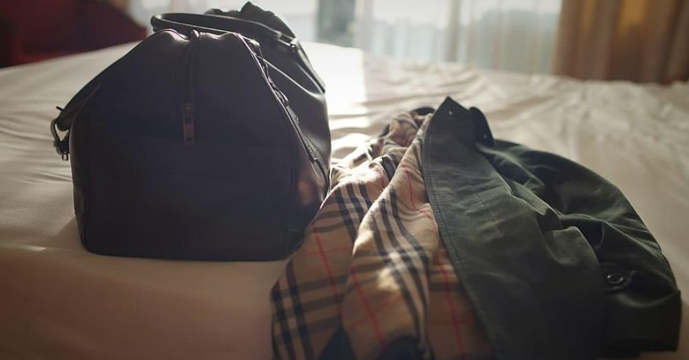 travel bags kept on the bed