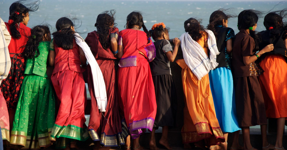 A group of girls looking at the sea