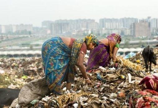 waste picker ragpicker lady at a landfill