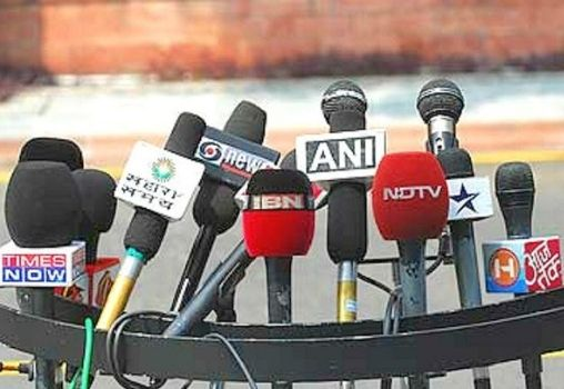 mics of TV news channels on a stand for an interview