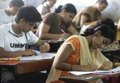students writing exam in the exam hall