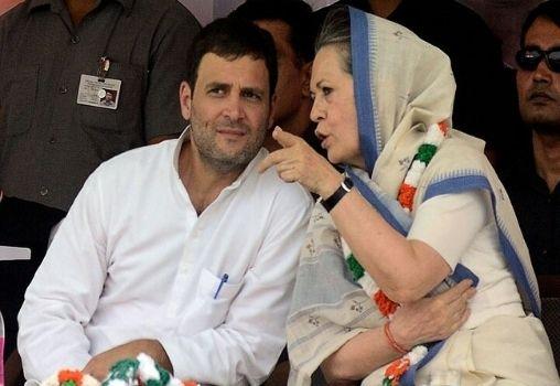 sonia gandhi talking to his son Congress President Rahul Gandhi