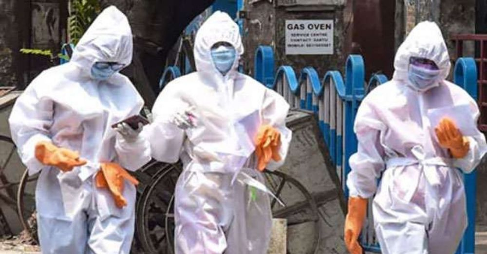 health officials in ppe