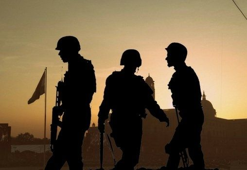 soldiers standing near the border in a silhouette