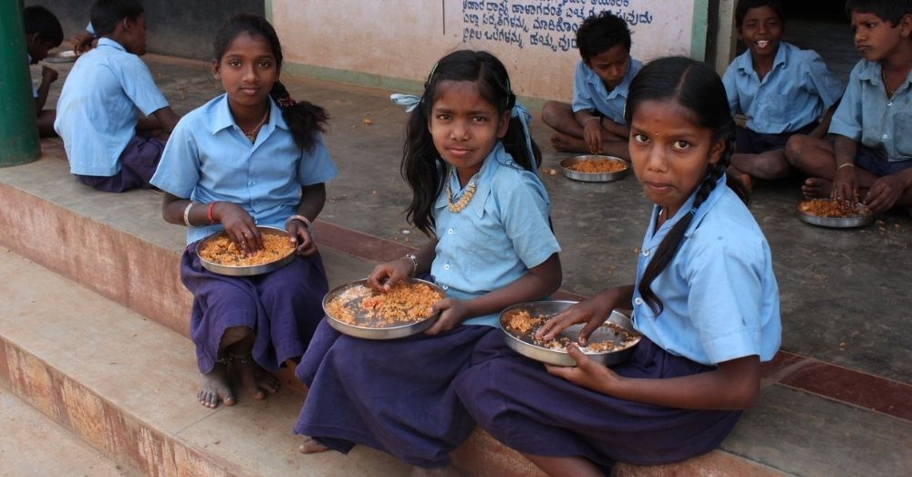Girls having mid day meal