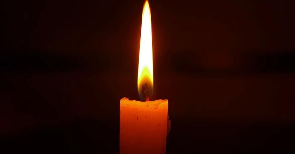 candle burning in the dark