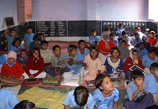 children sitting in a classroom