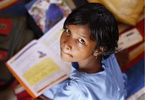 school girl reading book