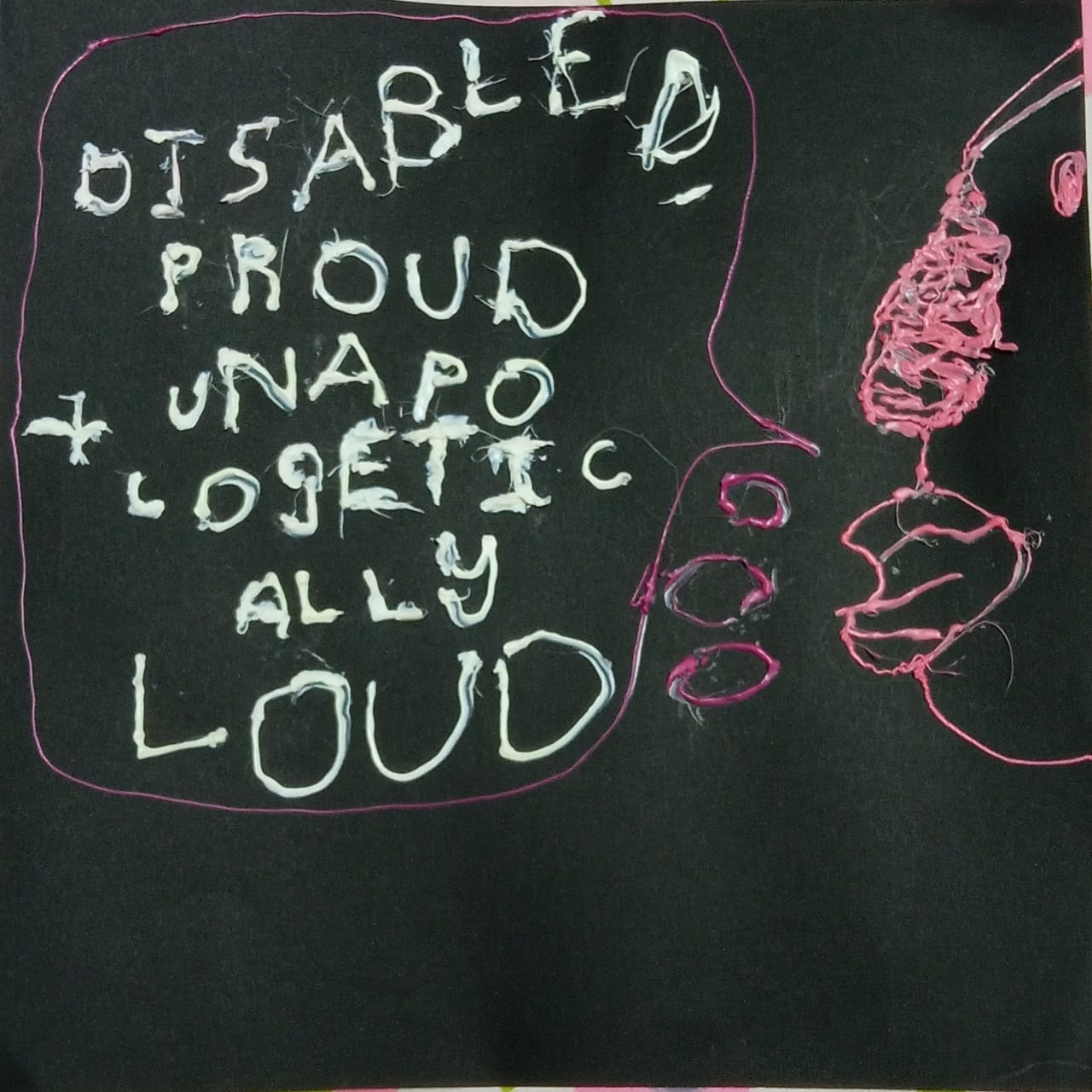 "the side view of a human face is drawn and embossed in pinkish peach on a black background. The lips are pouting and the mouth say's ""Disabled, proud and unapologetically loud"" in white capital letters. The entire picture seems to be embossed"