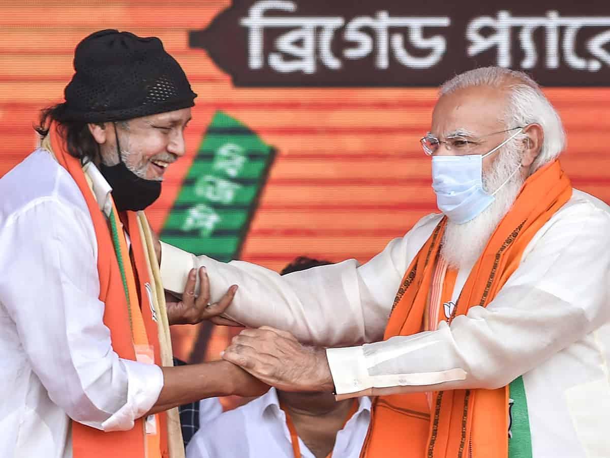 Mithun with Modi