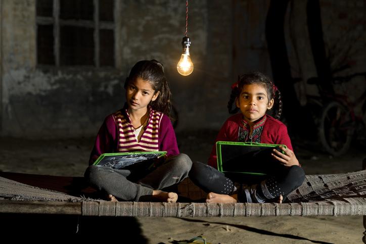 Rural girls studying in light bulb