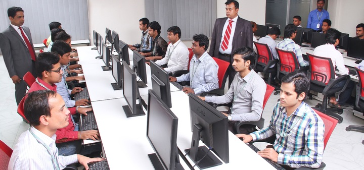 people in office using computer