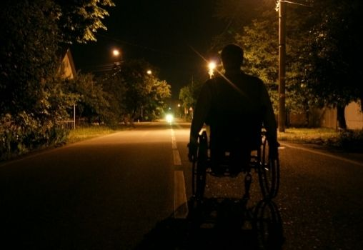 Man on a wheelchair out at night
