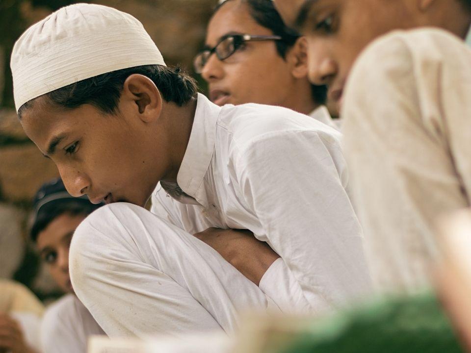 Muslim boy reading the Quran