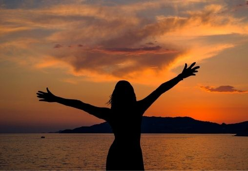 sunset woman silhouette happy