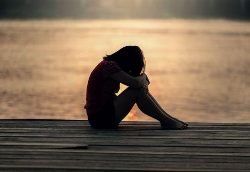 woman silhouette sad