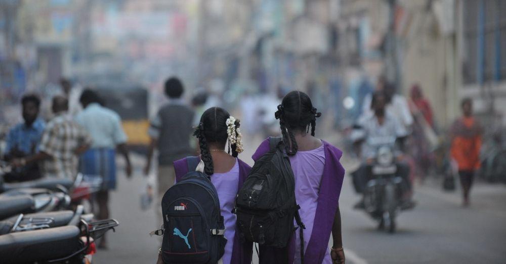 Two girls walking to school