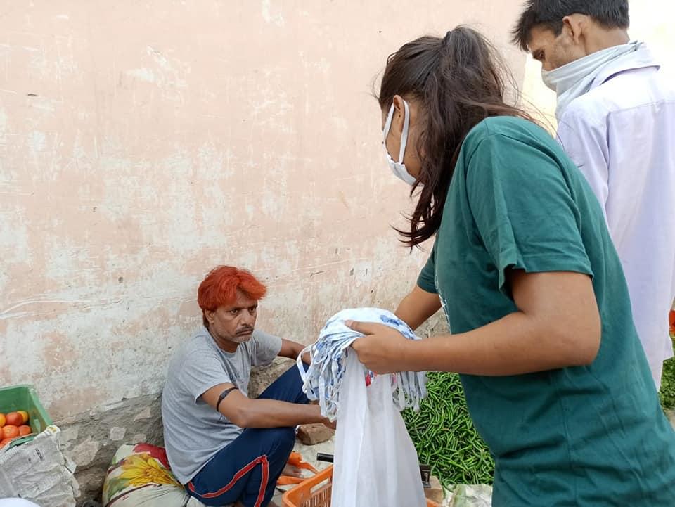 Youth distributing masks